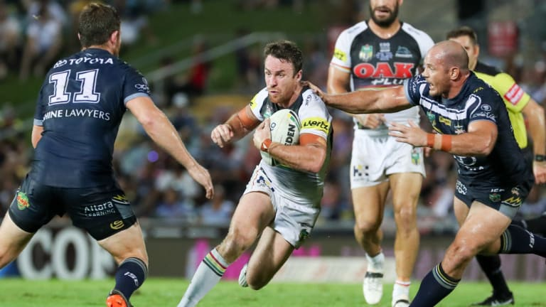 James Maloney of the Panthers looks for a gap in the Cowboys defence.