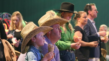 Dan O'Brien and Riley O'Brien, 4, watching the show of motorbike riders at the Ekka launch on Thursday.