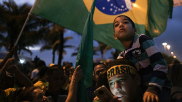 Supporters of Jair Bolsonaro wait for his victory speech, in Rio de Janeiro.