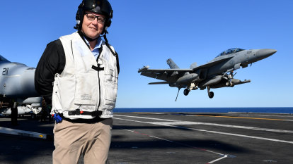 Morrison visits US aircraft carrier as Chinese ship watches war games