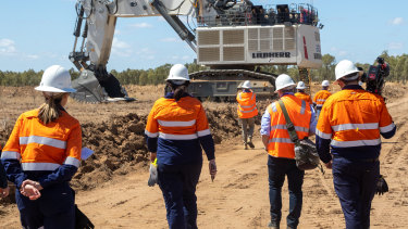 Workers at the Adani Carmichael coal mine this month.