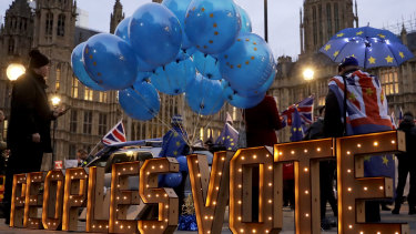 """The words """"Peoples Vote"""" call for another referendum on Brexit across the street from the Houses of Parliament in London on Monday."""