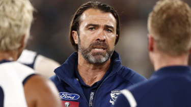 Geelong coach Chris Scott addresses his players during the MCG blockbuster against the Tigers.