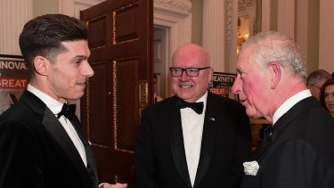 Prince Charles talks with Australian musical theatre star Josh Piterman and Australian High Commissioner George Brandis at the bushfire fundraiser. on March 12.