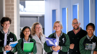 The Age has awarded Melba College its 2021 Schools that Excel government school winner for Melbourne's east. Students Harry Pearson, Hser Tin, Gemma van Rooy and Thang Zathang, L to R, and assistant principal Allirra Scott with acting principal Matt Lee.