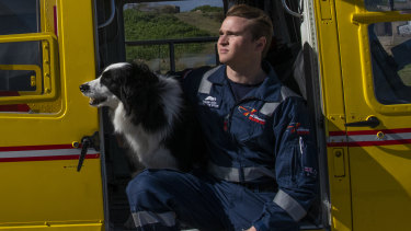 """""""The work that we do for the community is vital"""" Rescue diver Callum Good, at the Westpac Life Saver Rescue Service base in La Perouse with the base's dog, Whiskey."""