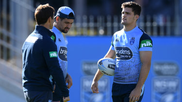 Half your luck: Nathan Cleary, right, and Cody Walker speak with league Immortal Andrew Johns at Blues training.