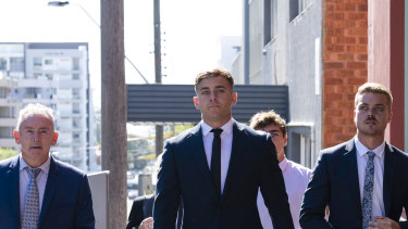 Callan Sinclair (centre) arrives at the NSW District Court in Wollongong.