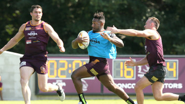 Segeyaro in action with Corey Oates (left) and Jake Turpin during training on Wednesday.