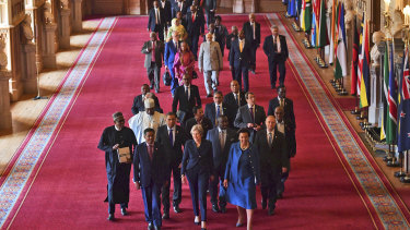 British Prime Minister Theresa May leads other Commonwealth leaders through Windsor Castle.