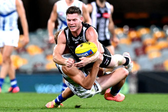 In the thick of it: Collingwood star Taylor Adams.