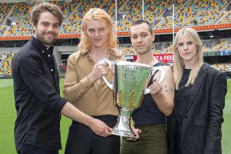 Cub Sport: Dan Puusaari (left), Tim Nelson, Sam Netterfield and Zoe Davis, with the AFL Premiership Cup.