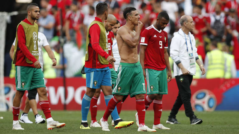Eliminated: Morocco's players leave the pitch after their second-straight loss.