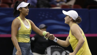 Barty (right) and Priscilla Hon celebrate a point in the doubles.