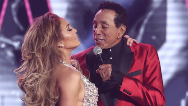 Lopez and Smokey Robinson at the Grammys.