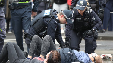Activists glued themselves to the road last month during anti-mining protests in Melbourne.