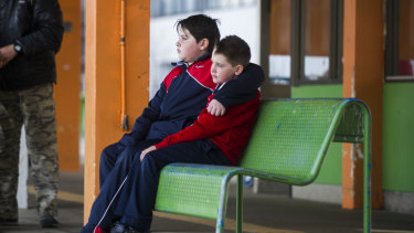 Noah Sham, 10, and Elijah Sham, 7, of Brindabella Christian College would have had to get on a public bus and make multiple connections to get to school from the Woden bus interchange under the new network.