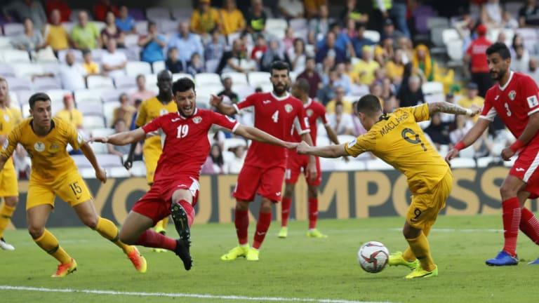 Mad scramble: Australian striker Jamie Maclaren attempts to shoot past Jordan defender Anas Bani Yaseen.