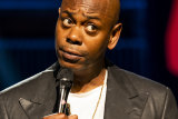 Dave Chappelle on stage performing his Netflix special, The Closer.