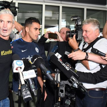 Craig Foster and media flank Hakeem al-Araibi on his return to Australia.