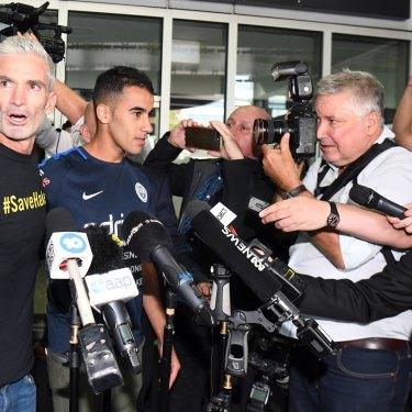 Craig Foster and media flank Hakeem al-Araibi on his return to Australia.