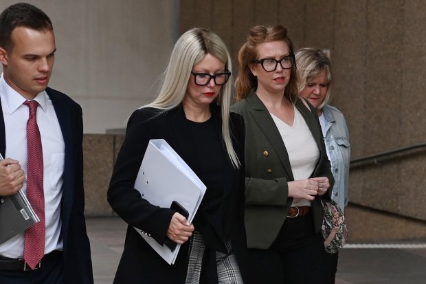 Elaine Stead, centre, and her sister Olivia, right, outside the Federal Court in Sydney on Wednesday.