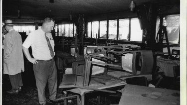 A detective examines the fire-damaged interior of the Whiskey Au Go Go nightclub on March 8, 1973
