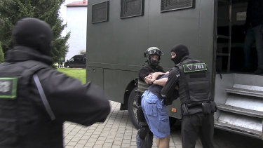 Belarusian KGB officers detain a Russian man in a sanitarium outside Minsk, Belarus.