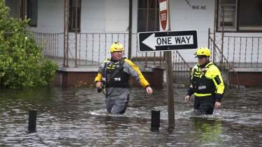 Members of the Greenville Fire Department swift water team go house to house checking flooded homes following Florence on Saturday.