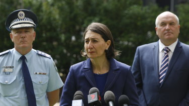 Police Commissioner Mick Fuller, Premier Gladys Berejiklian and Police Minister David Elliott on Saturday.