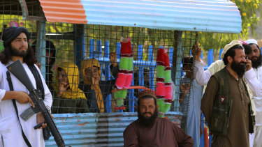 Taliban fighters stand guard on their side at a border crossing point between Pakistan and Afghanistan.