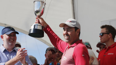 Mark Richards hoists the J.H. Illingworth trophy after Wild Oats XI arrived in Hobart.