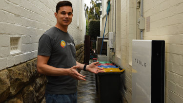 Carl Prins shows the Tesla Powerwall that is installed at his home in Waverley.