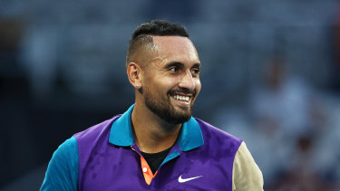 Nick Kyrgios smiles after winning a five-set epic against Frenchman Ugo Humbert at this year's Australian Open.