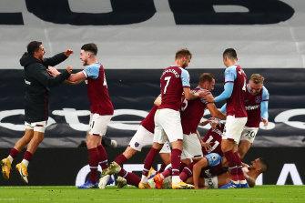 West Ham celebrate Manuel Lanzini's injury-time equaliser.