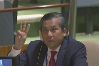 Myanmar Ambassador to the United Nations Kyaw Moe Tun flashes the three-fingered, a gesture of defiance used by protesters in Myanmar, at the end of his speech to the UN General Assembly in February.