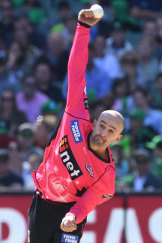 Back in the action: Nathan Lyon bowls against the Stars.