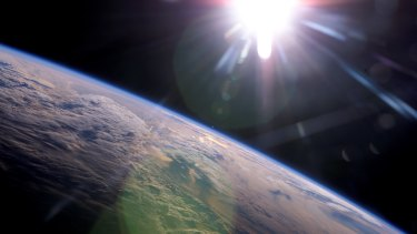 This image, taken from the International Space Station, shows the sun. Note how its light glows white, rather than yellow.