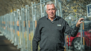 Mother Teresa Catholic Primary School principal Peter Hughes in the school car park, where garden beds have been fenced off after the discovery of asbestos.