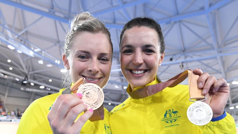 Annette Edmondson (left, pictured with fellow cyclist Rebecca Wiasak at the 2018 Commonwealth Games) is owed more than $2000.