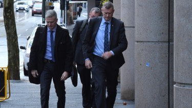 AFP officers arriving at the ABC on Wednesday.