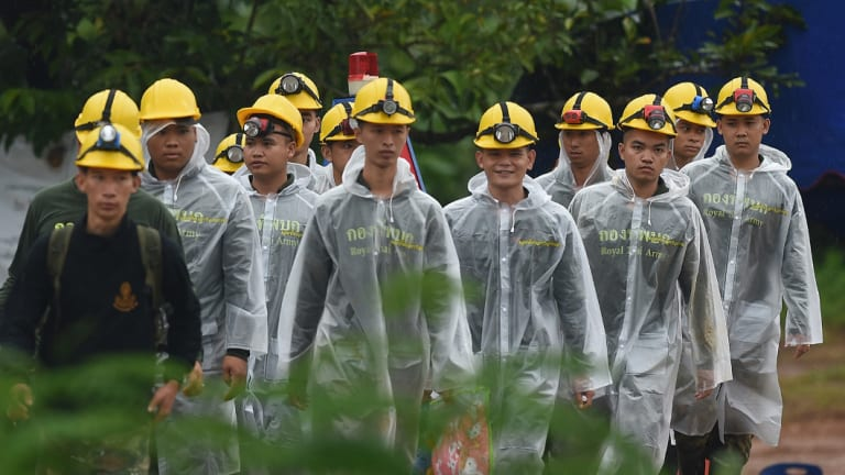 Thai army soldiers return from Tham Luang cave on day three of the rescue operation.