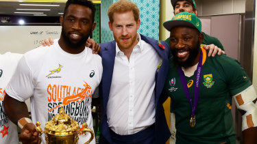 Royal seal: Prince Harry, Duke of Sussex, with Siya Kolisi holding the Web Ellis Cup and prop Tendai Mtawarira.