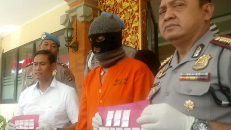 Johnsson being paraded in an orange jumpsuit by Indonesian police on Thursday at a press conference.