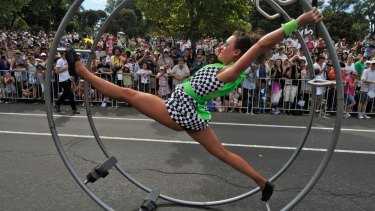 An acrobat takes part in the Moomba parade.