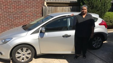 Nalini Devi Thiruvangadam with the car she bought that triggered a downward financial spiral.