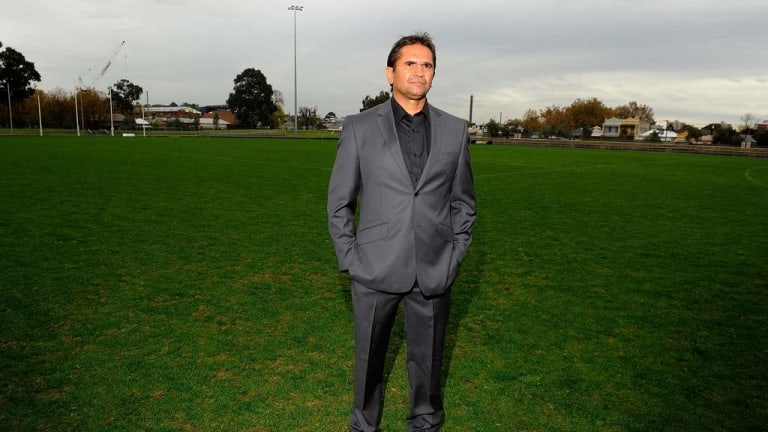 Nicky Winmar stands on the patch of ground at Victoria Park where the picture was taken of him pointing to the colour of his skin, at the launch of the 2013 AFL Indigenous Round.