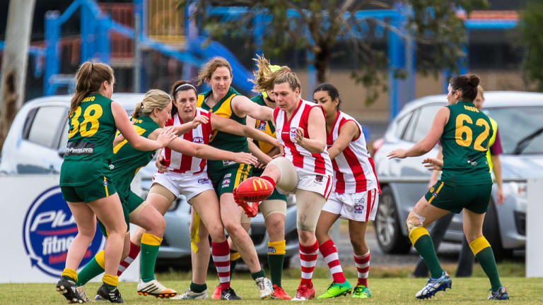 Jill Chalmers, in red and white guernsey for Mordialloc, kicking the football on May 7, 2017, at Barry Simon Reserve, Endeavour Hills.