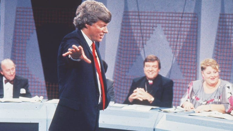 """Conducting an ABC TV Hypothetical on medical ethics, """"Affairs of the Heart"""", in 1989; even panellist George Pell seems amused."""