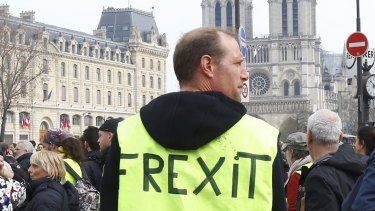 Protesters take part in the 19th weekend rally in Paris, on Saturday.